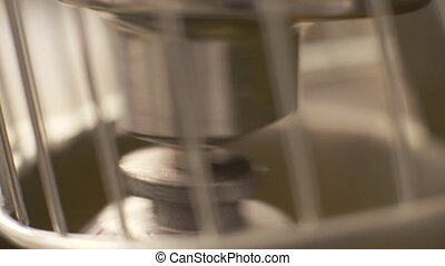 Close up mixing and kneading dough in automatic mixer on...