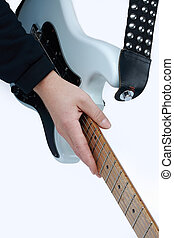 close-up. modern electric guitar in the hands of the guitarist .