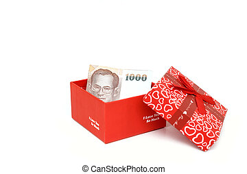 Close up money in red Gift box isolated on white background