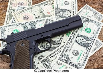 Close up money with Gun. - Close up money with Gun on wood ...