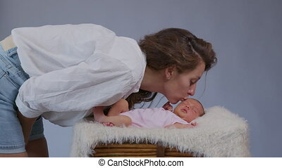 close up mother gently kissing baby enjoying loving mom playfully caring for toddler sharing connection with her newborn child healthy childcare