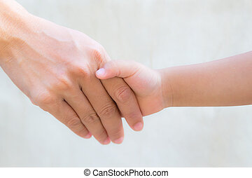 Close up mother holding a hand of his son