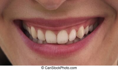 Close-up mouth of woman with beautiful lips and white teeth...
