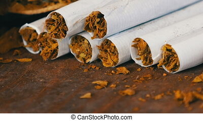 Close up od homemade cigarettes or roll-up next to dry...