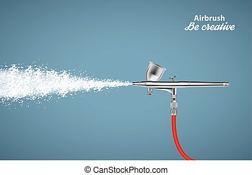 Close up of a airbrush paint sprayer isolated on blue...