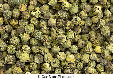 close up of a background of green peppercorns