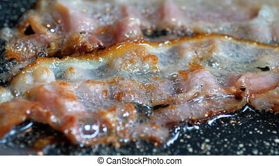 Close-up of a  Bacon Fried On Grill