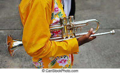 Close-up of a band member holding a trumpet
