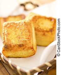 close up of a basket of fried tofu cubes