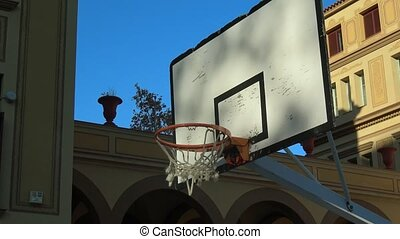 Close up of a basketball going through the net - A...