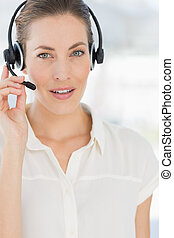 Close-up of a beautiful female executive with headset