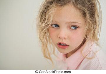 Close-up of a beautiful serious young girl
