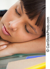 Close-up of a beautiful student sleeping