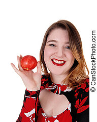 Close up of a beautiful woman holding a red apple