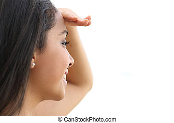 Close up of a beautiful woman looking with a hand in forehead