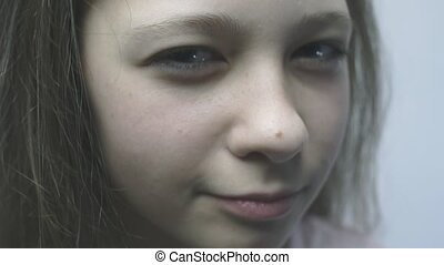 Close-up of a beautiful young girl looking at the camera.