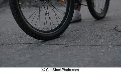 Close-up of a bicycle start on an asphalt road.