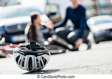 Close-up of a bicycling helmet fallen down on the ground after a
