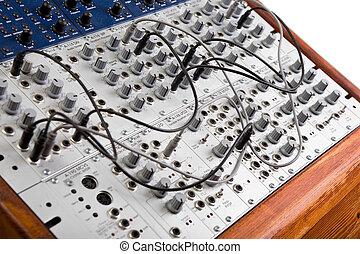 close up of a big modular synthesizer
