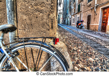 Close up of a bike wheel in Alghero old town