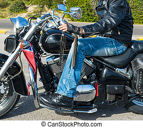 Close up of a biker on a classic motorcycle