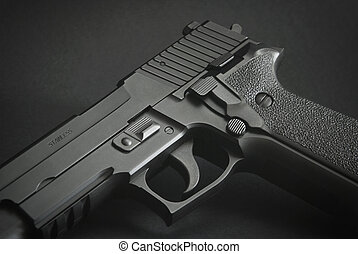 close up of a black automatic firearm