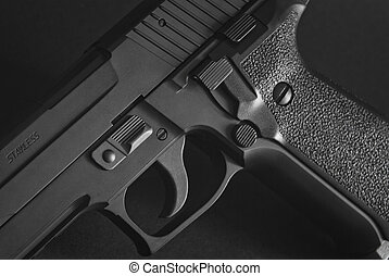 black automatic firearm - close up of a black automatic...