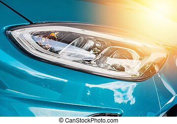 Close up of a blue sport car in sunset