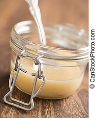 close up of a bottle of sweetened condensed milk