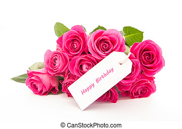 Close up of a bouquet of pink roses with a happy birthday blank day card on a white background