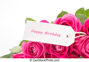 Close up of a bouquet of pink roses with a happy birthday card on a white background