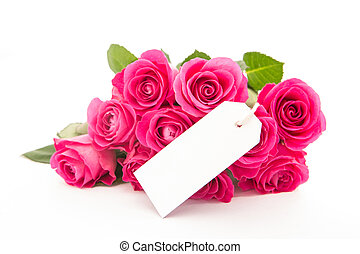 Close up of a bouquet of pink roses with an empty card on a white background