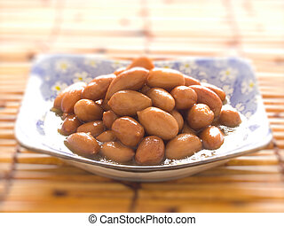 close up of a bowl of braised peanuts