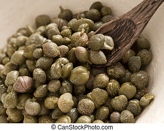 capers - close up of a bowl of capers