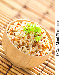 close up of a bowl of garlic fried rice