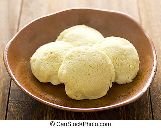 close up of a bowl of indian idlis