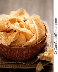 potato crisps - close up of a bowl of potato crisps