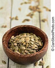 close up of a bowl of pumpkin seeds