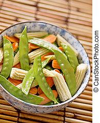 close up of a bowl of stir fried vegetables