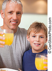 Close up of a boy and his father having breakfast