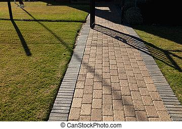 Close up of a brick paved pedestrian walkway