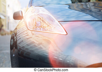 Close up of a bright big glowing headlamp of a car - Shining...