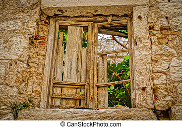 close-up of a broken window in abandoned house. HDR picture