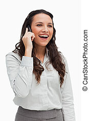 Close-up of a brunette smiling while phoning