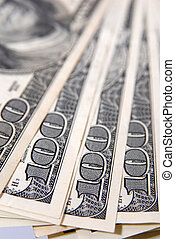 Close up of a bundle of hundred-dollar bills