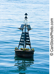 Close-up of a buoy in the blue sea