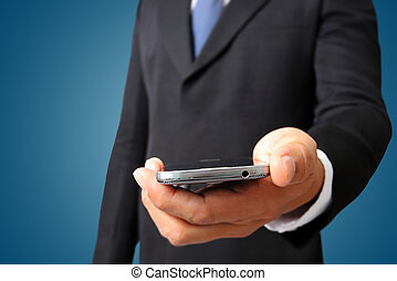 Close up of a business man holding mobile smart phone
