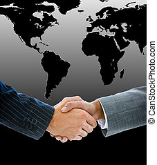 Close-up of a business people shaking hands against a black...