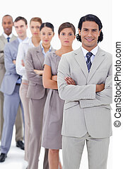 Close-up of a business team crossing their arms in a single...