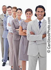 Close-up of a business team in a single line crossing their...
